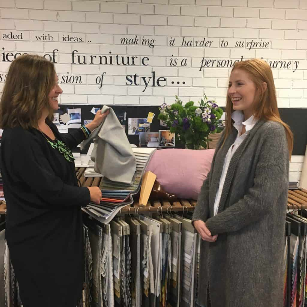 Our Melbourne Showroom Manager, Michelle helping Courtney choose her fabric.
