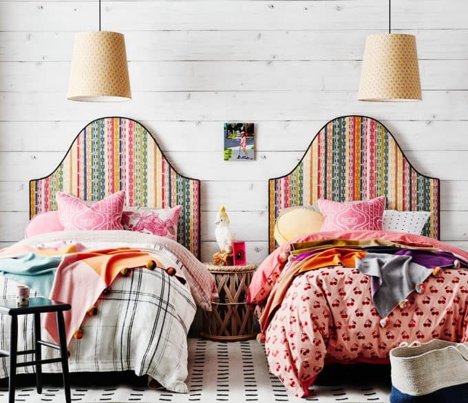 Genevieve bedhead finished in Kahuna multi, lampshades finished in Paniola yellow, pink, navy