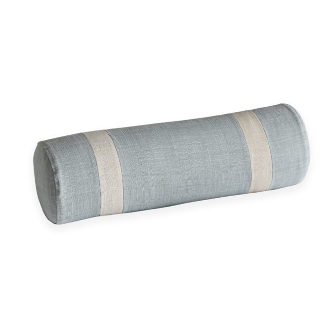 Bolster cushion in linen bed decor