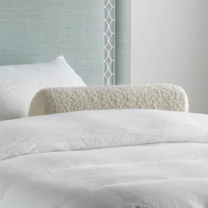 Bolster cushion in boucle white ivory bed decor