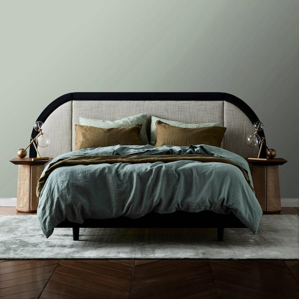 Marcel bed head curved bordered upholstered linen